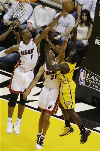 Miami Heat center Chris Bosh (1) blocks a shot to the basket by Indiana Pacers guard Lance Stephenson (1) as Heat forward Shane Battier (31) defends during the first half of Game 2 in their NBA basketball Eastern Conference finals playoff series, Friday, May 24, 2013, in Miami