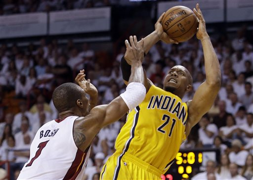 Indiana Pacers forward David West (21) attempts a basket over Miami Heat defender Chris Bosh (1) during the first half of Game 2 in their NBA basketball Eastern Conference finals playoff series, Friday, May 24, 2013, in Miami