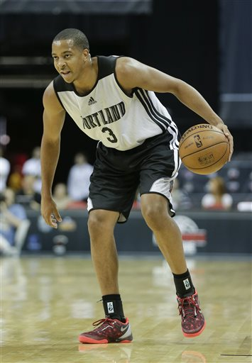 Portland Trail Blazers' C.J. McCollum sets the offense against the Phoenix Suns in the second quarter of an NBA Summer League basketball game onSaturday, July 13, 2013, in Las Vegas