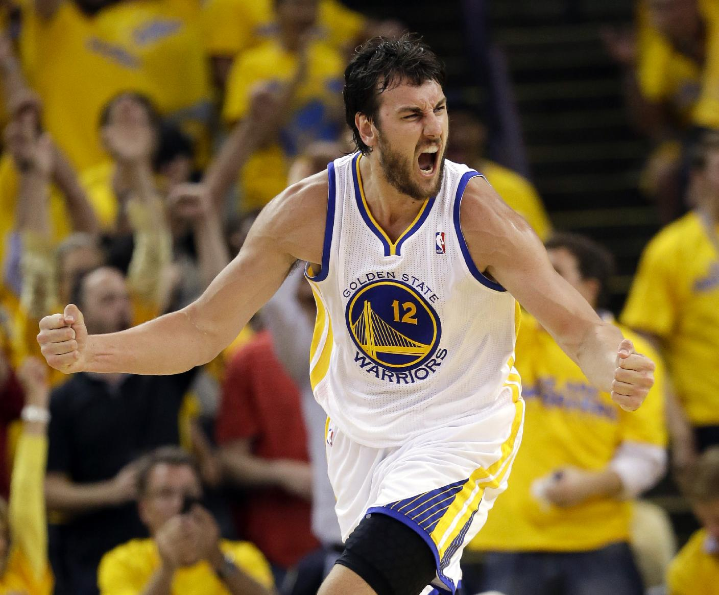 In this May 2, 2013 file photo, Golden State Warriors' Andrew Bogut celebrates scoring against the Denver Nuggets during an NBA basketball game in Oakland, Calif. Bogut says he is