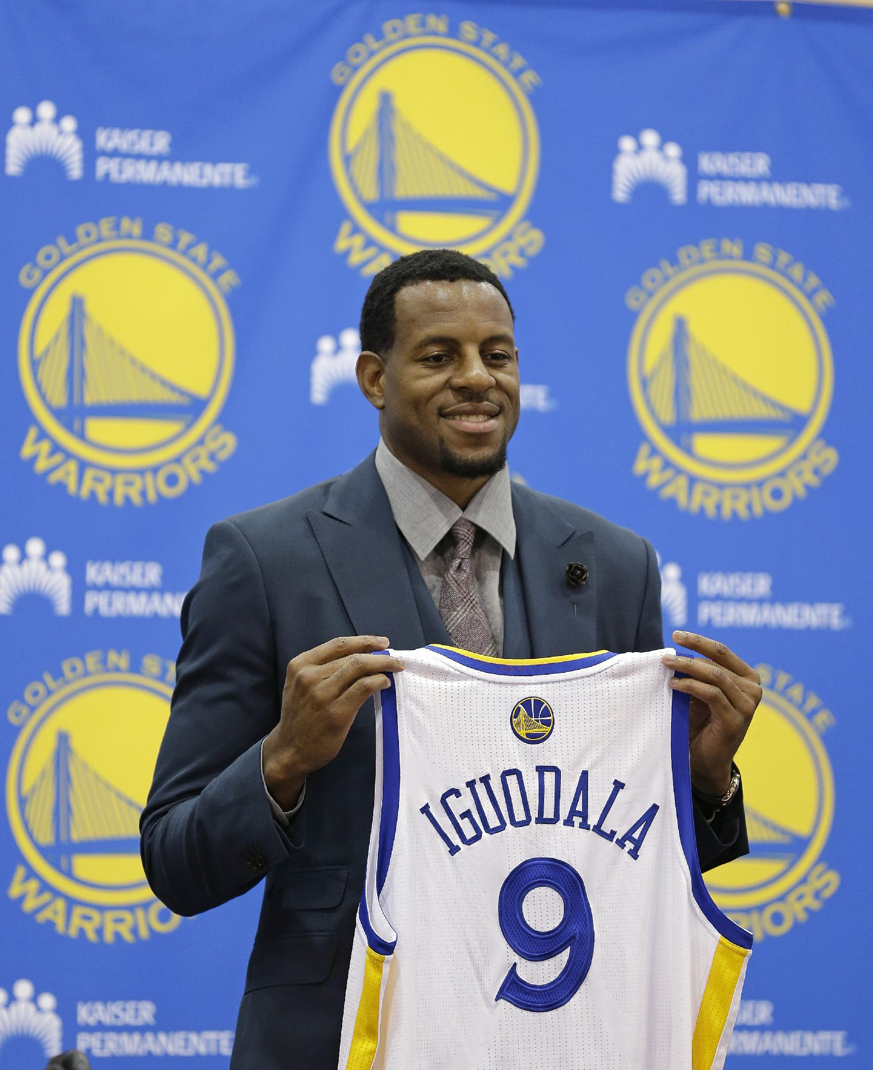 In this July 11, 2013, file photo, Andre Iguodala poses with his jersey after being introduced by the Golden State Warriors NBA basketball team at a news conference in Oakland, Calif. Iguodala said Wednesday, Sept. 18, that Golden State is aiming for