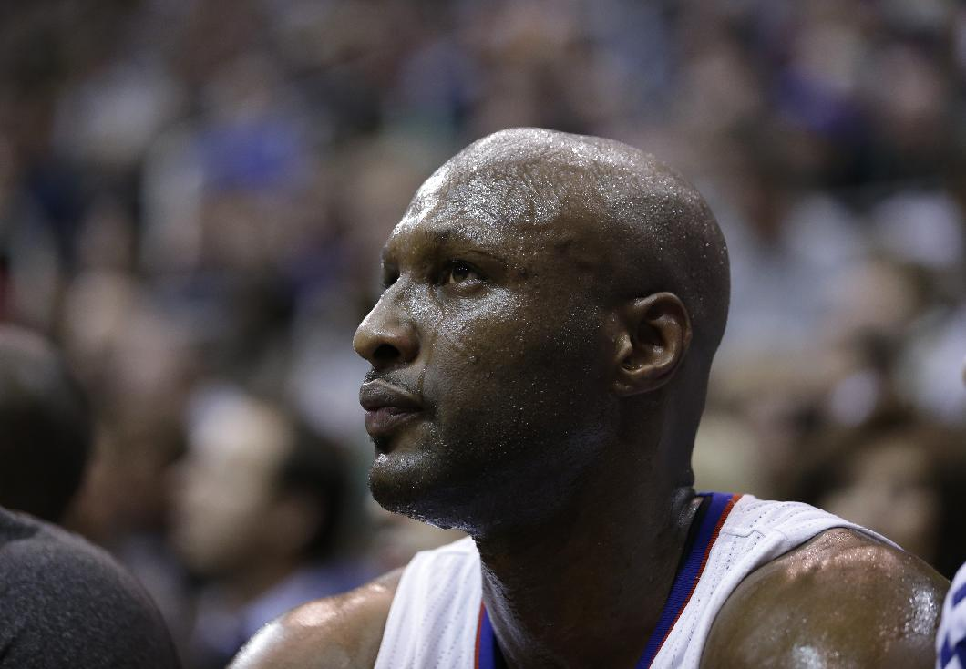In this Dec. 28, 2012 file photo, Los Angeles Clippers power forward Lamar Odom sits on the bench during the second half of an NBA game against the utah Jazz, in Salt Lake City. Odom is breaking his silence with his first post on Twitter since the NBA star was arrested and charged with driving under the influence last month. Odom tweeted