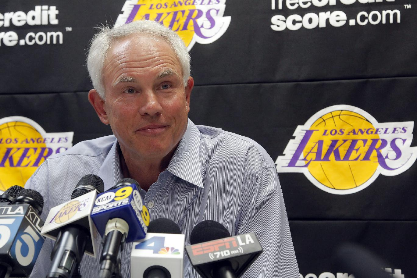 Mitch Kupchak, Los Angeles Lakers general manager, speaks to reporers about the upcoming season, Wednesday Sept. 25, 2013, in El Segundo, Calif. Kupchak says Kobe Bryant was at the NBA basketball team's training complex almost every morning this summer, working aggressively to return from surgery on his torn left Achilles' tendon