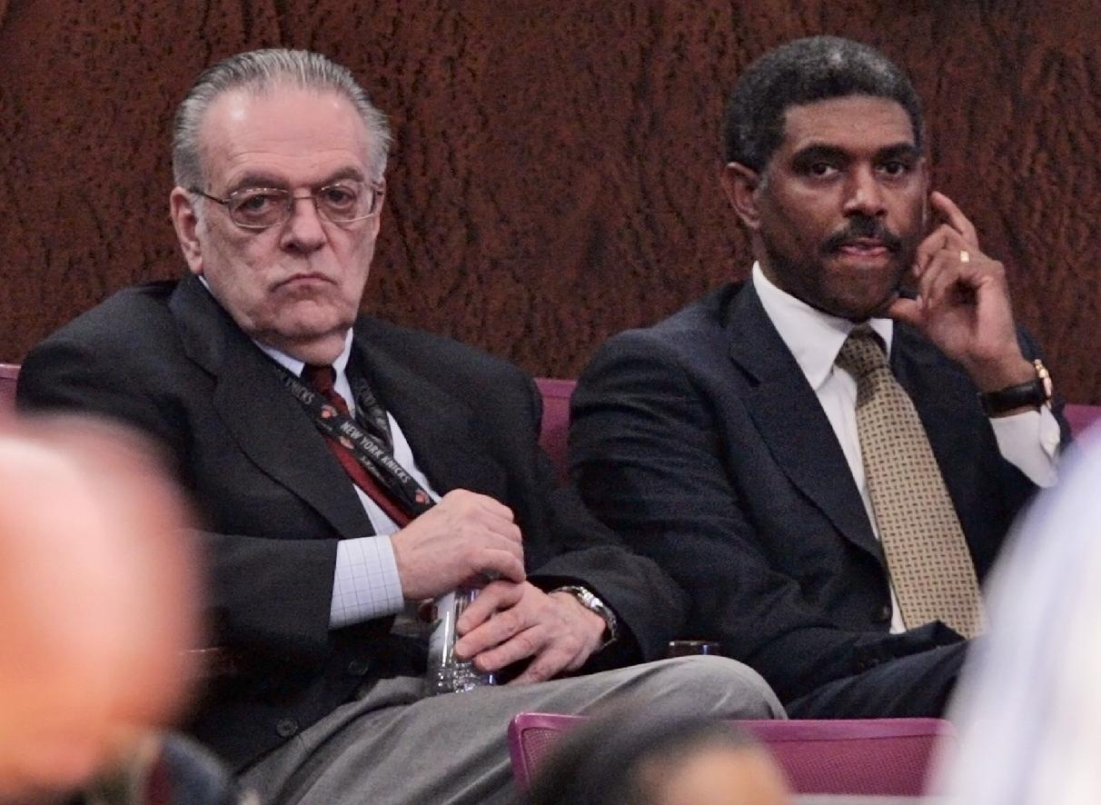In this April 9, 2008, file photo, New York Knicks president Donnie Walsh, left, and MSG sports president Steve Mills look on during the first half of a basketball game between the Knicks and the Charlotte Bobcats in New York.  Mills is returning to the New York Knicks as president and general manager, replacing Glen Grunwald in a front-office shake-up just days before the start of training camp, the team announced Thursday, Sept. 26, 2013.  Mills left MSG in 2009 after the arrival of Donnie Walsh as Knicks president