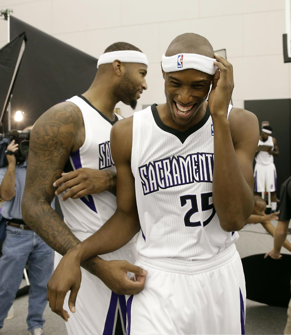 Sacramento Kings center DeMarcus Cousins, left, jokes with teammate Travis Outlaw during the team's NBA basketball media day in Sacramento, Calif., Monday, Sept. 30, 2013