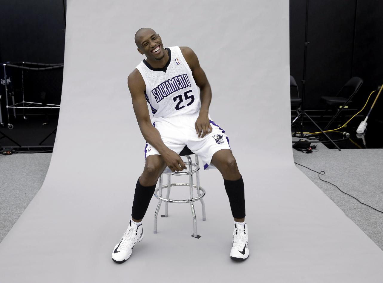 Sacramento Kings forward Travis Outlaw laughs while having his photo taken during the team's NBA basketball media day in Sacramento, Calif., Monday, Sept. 30, 2013