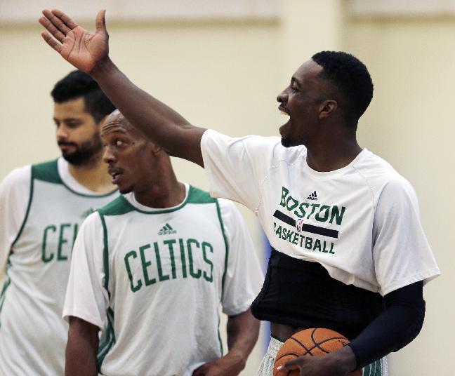 Boston Celtics forward Jeff Green jokes with teammates during their NBA basketball training camp at Salve Regina University, Wednesday, Oct. 2, 2013, in Newport, R.I