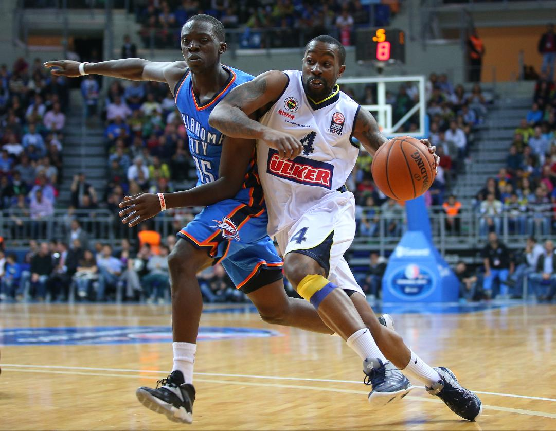Bo McCalebb of Fenerbahce Ulker, right, passes the ball around Oklahoma City Thunder's Reggie Jackson, during a basketball game in Istanbul, Turkey, Saturday, Oct. 5, 2-13. Oklahoma City Thunder has opened the preseason schedule with a game against five-time Turkish champion at the Ulker Sports Arena. (AP Photo)
