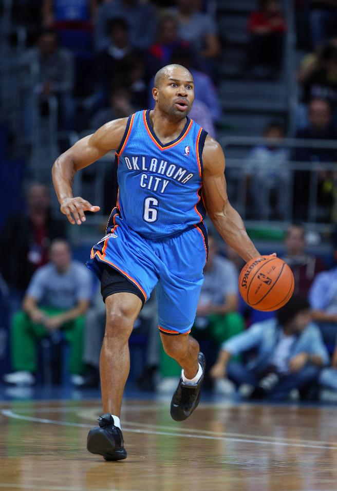 Oklahoma City Thunder's Derek Fisher drives the ball to basket during a preseason basketball game in Istanbul, Turkey, Saturday, Oct. 5, 2-13. Oklahoma City Thunder has opened the preseason schedule with a game against the five-time Turkish champions at the Ulker Sports Arena.  (AP Photo)