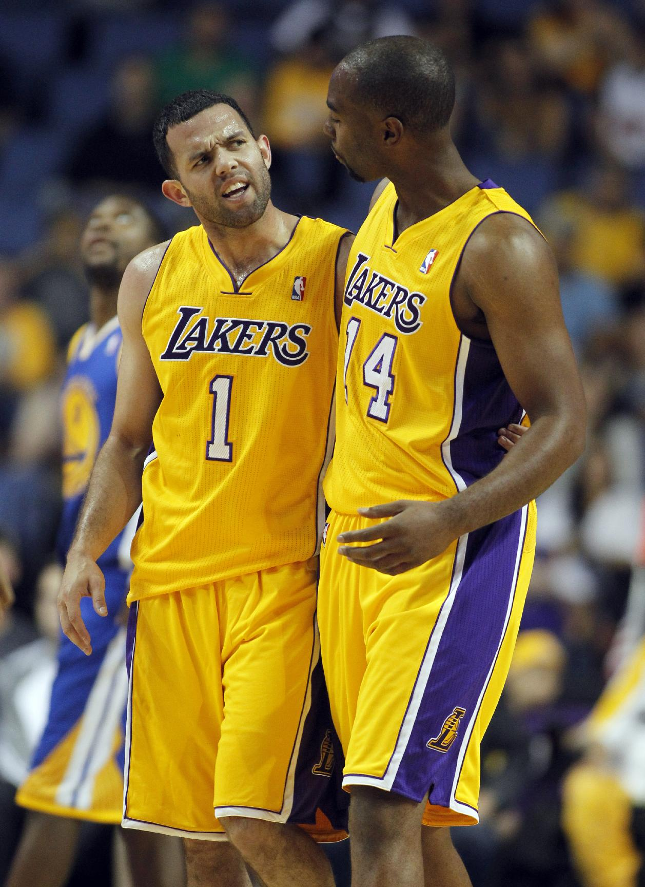 Los Angeles Lakers forward Marcus Landry, right, congratulates Lakers guard Jordan Farmar, left, after making a shot and collecting a foul against the Golden State Warriors in the fourth quarter during an NBA basketball preseason game Saturday, Oct. 5, 2013, in Ontario, Calif. Lakers won the game 104-95