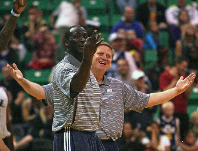 Jazz head coach Tyrone Corbin, left, teases the losing team for their three point loss.  Utah Jazz fans filled  EnergySolutions Arena Saturday to get a glimpse at this year's players during the annual scrimmage Saturday, Oct. 5, 2013. The Jazz roster currently includes 20 players, but NBA rules require that that number must be reduced to 15 by opening night, Oct. 30 against Oklahoma City