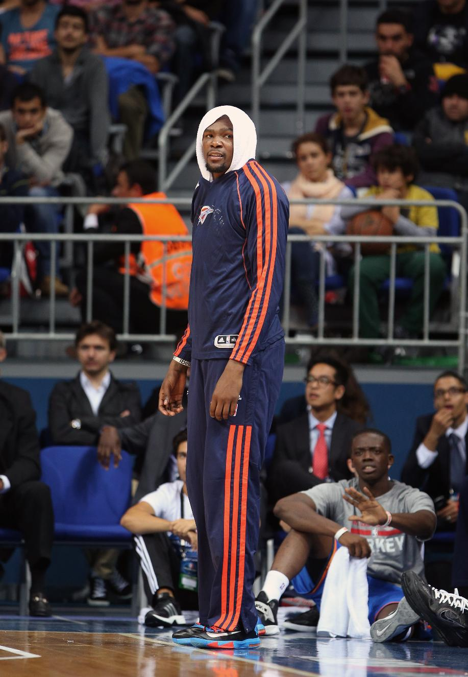 The NBA team Oklahoma City Thunder's Kevin Durant looks on to playing teammates during a preseason basketball game in Istanbul, Turkey, Saturday, Oct. 5, 2-13. Oklahoma City Thunder has opened the preseason schedule with a game against the five-time Turkish champions at the Ulker Sports Arena.(AP Photo)