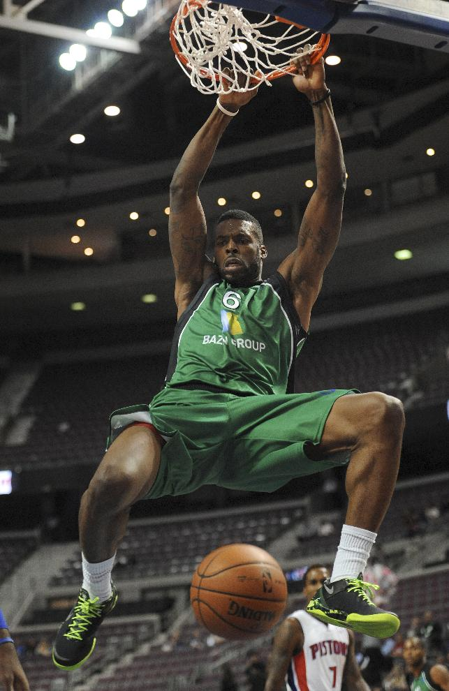 Maccabi Haifa forward Donta Smith dunks against the Detroit Pistons during the first quarter of an NBA preseason basketball game at the Palace of Auburn Hills, Mich., Tuesday, Oct. 8, 2013