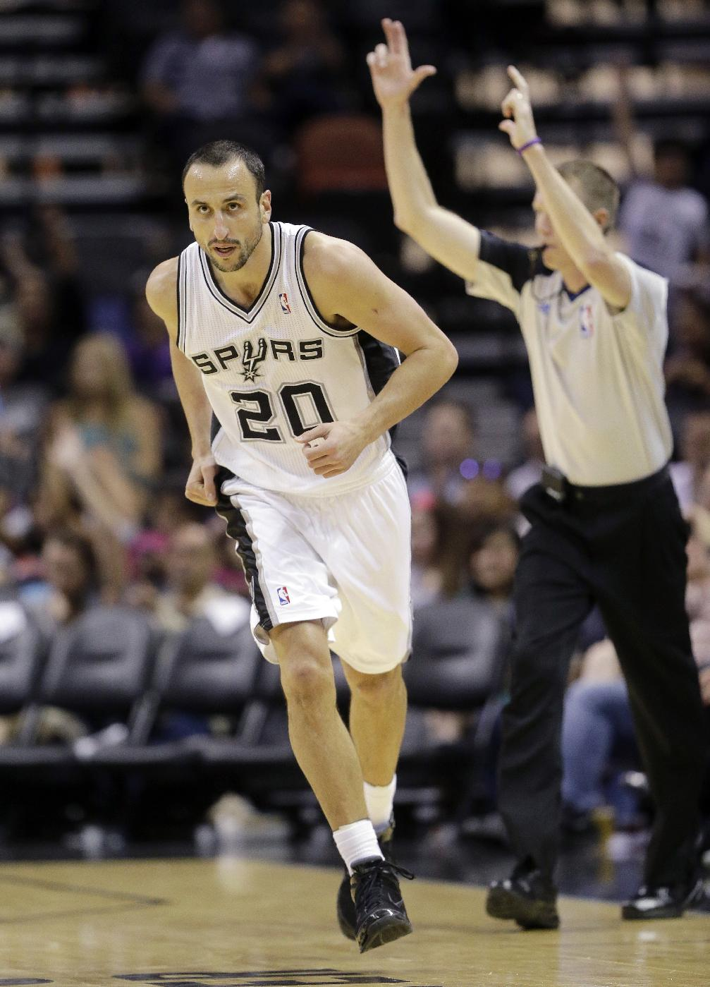 San Antonio Spurs' Manu Ginobili, of Argentina, runs up court after scoring against CSKA Moscow during the second half of an exhibition NBA basketball game, Wednesday, Oct. 9, 2013, in San Antonio. San Antonio won 95-93 in overtime