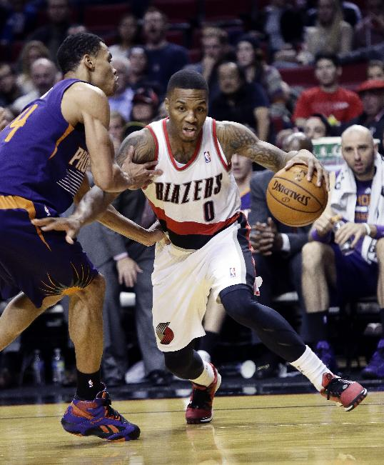 Portland Trail Blazers guard Damian Lillard, right, drives on Phoenix Suns forward Gerald Green during the second half of an NBA preseason basketball game in Portland, Ore., Wednesday, Oct. 9, 2013.  Lillard led the Trail Blazers in scoring with 19 points as the Suns won 104-98