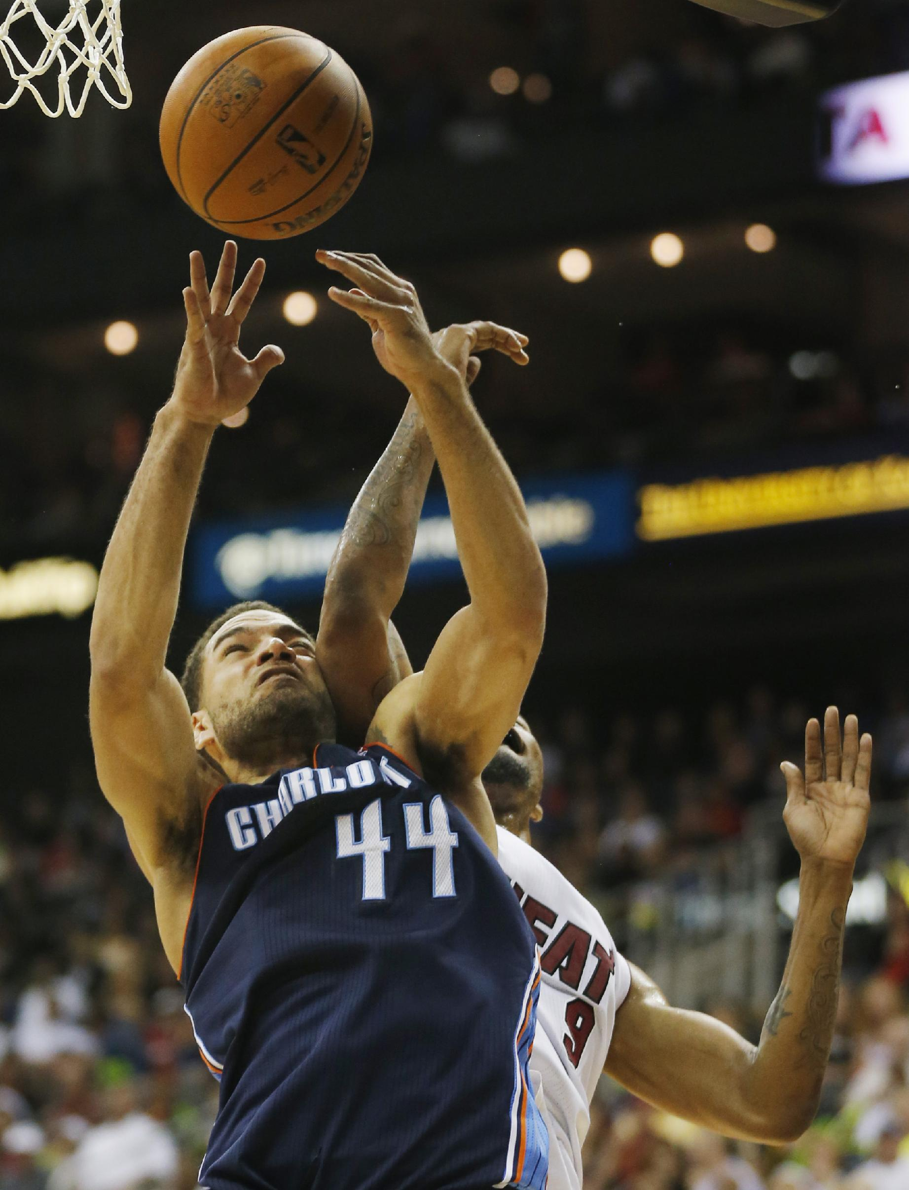 Charlotte Bobcats forward Jeffery Taylor (44) catches an elbow from Miami Heat forward Rashard Lewis (9) during the second half of a preseason NBA basketball game in Kansas City, Mo., Friday, Oct. 11, 2013. The Heat defeated the Bobcats 86-75