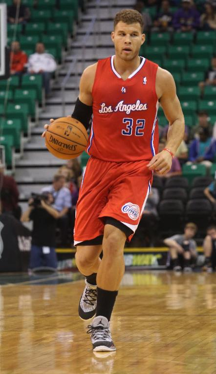 Los Angeles Clippers' Blake Griffin (32) dribbles down court in the first half during an NBA preseason basketball game against the Utah Jazz Saturday, Oct. 12, 2013, in Salt Lake City