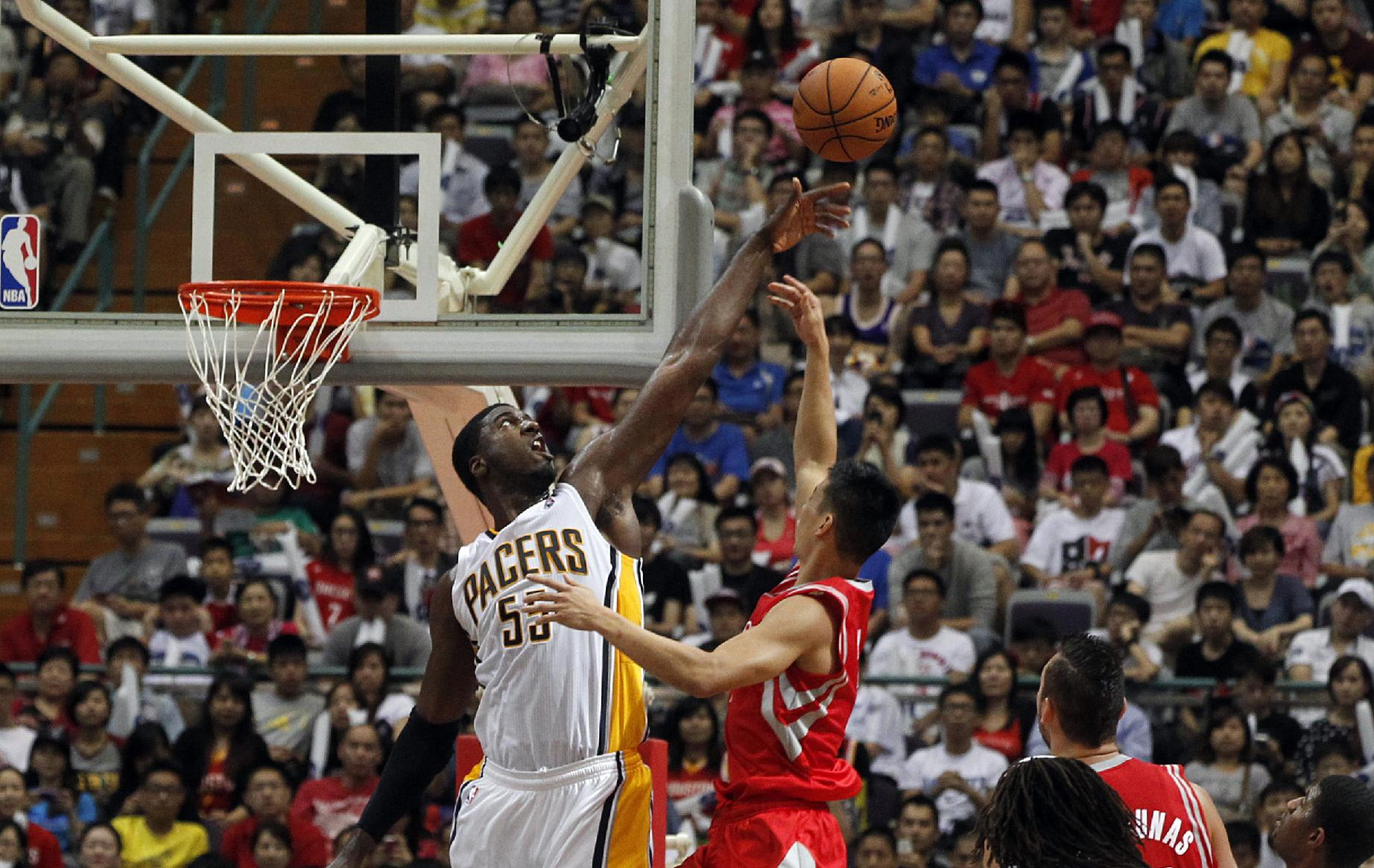 NBA Indiana Pacers Roy Hibbert (55) tries to block Houston Rockets Jeremy Lin, center, during a preseason game in Taipei, Taiwan, Sunday, Oct. 13, 2013. The Rockets beat the Pacers 107-98