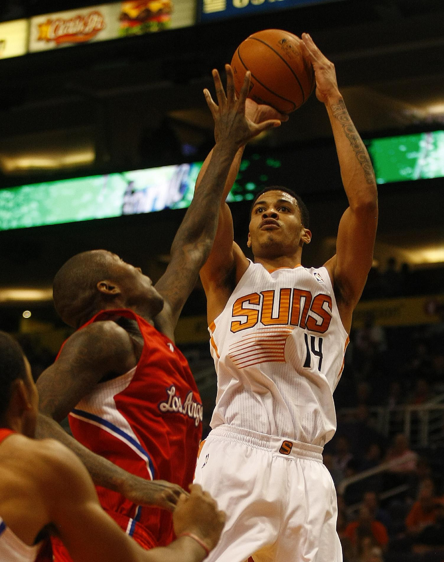 Phoenix Suns shooting guard Gerald Green (14) shoots against the Los Angeles Clippers in the third quarter during an NBA preseason basketball game on Tuesday, Oct. 15, 2013, in Phoenix