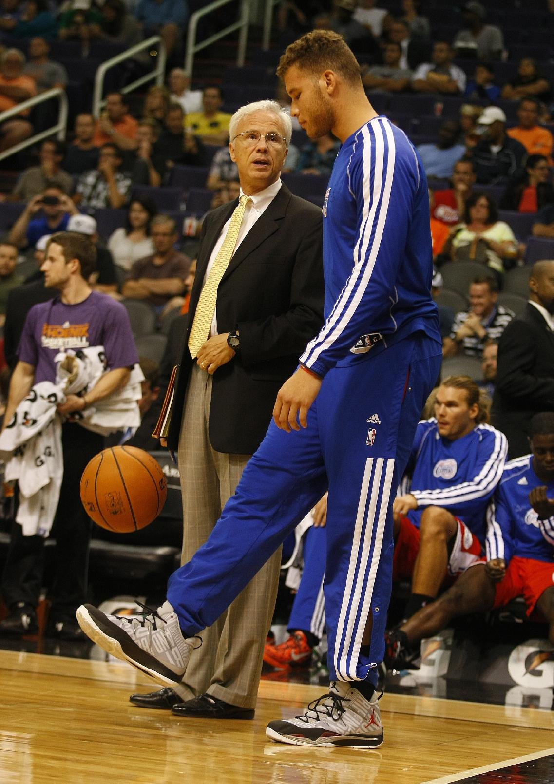 Los Angeles Clippers power forward Blake Griffin (32) juggles the basketball with his feet in the third quarter during an NBA preseason basketball game against the Phoenix Suns on Tuesday, Oct. 15, 2013, in Phoenix. Griffen did not play against the Suns