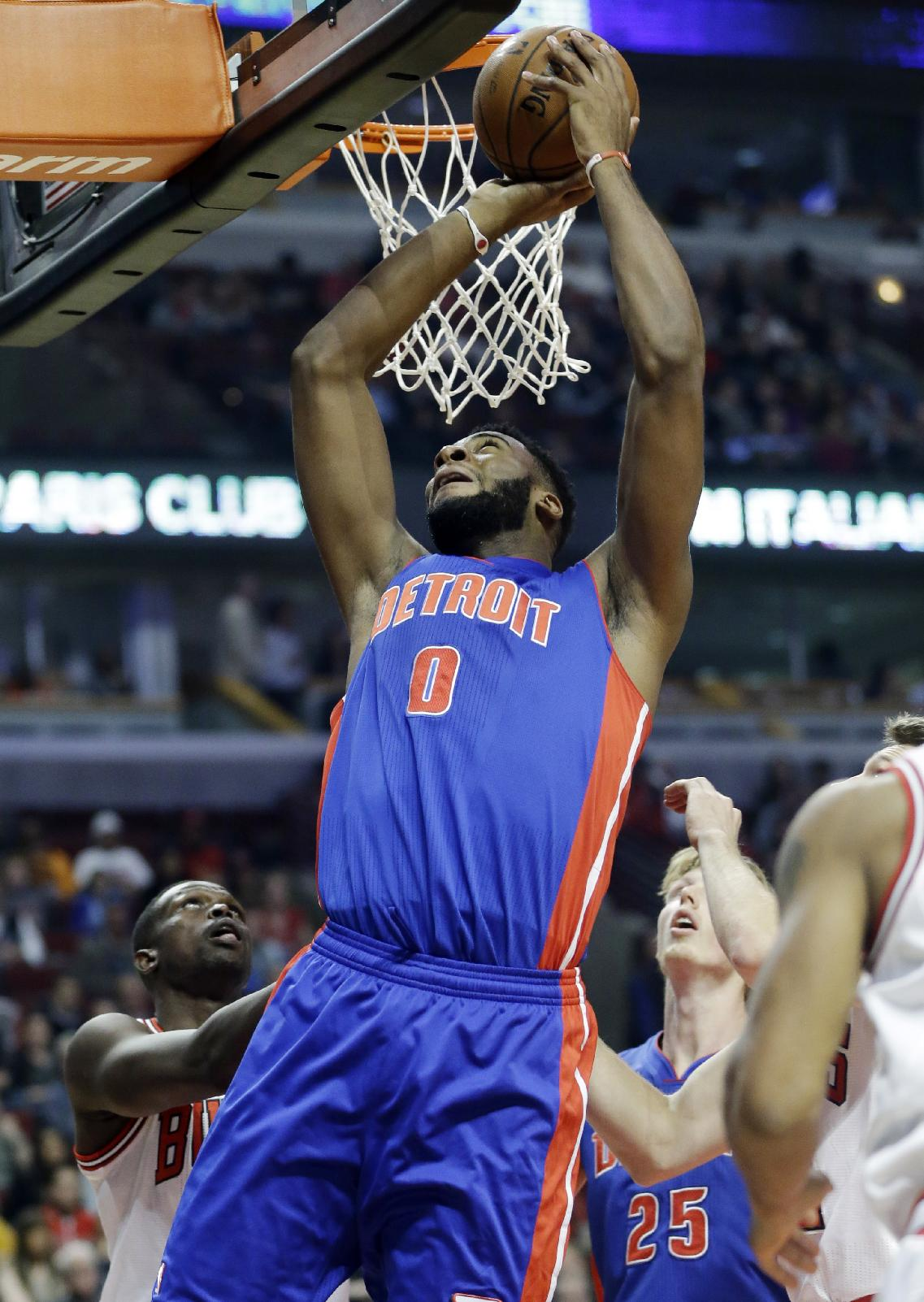 Detroit Pistons center Andre Drummond (0) goes up for a shot against the Chicago Bulls during the first half of an NBA preseason basketball game in Chicago on Wednesday, Oct. 16, 2013
