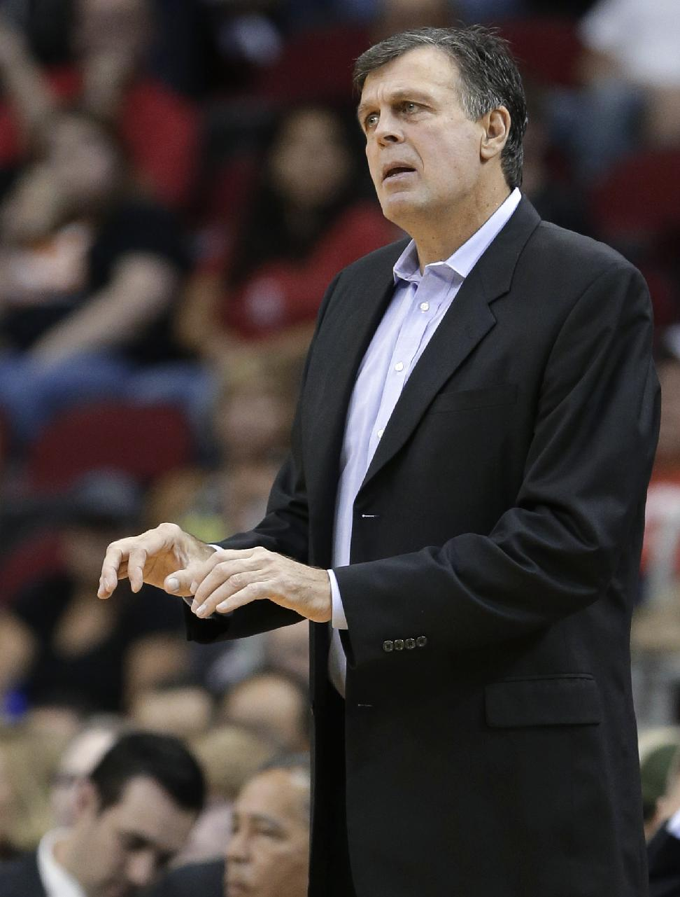 Houston Rockets coach Kevin McHale gestures to his players in the first half of an NBA preseason basketball game against the Orlando Magic on Wednesday, Oct. 16, 2013, in Houston