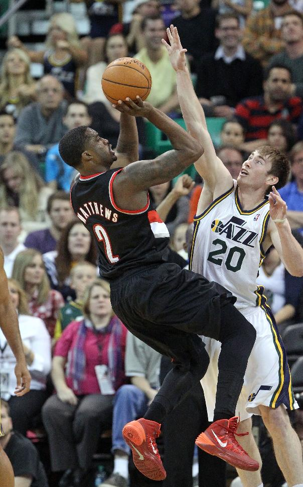 Portland Trail Blazers' Wesley Matthews (2) shoots as Utah Jazz's Gordon Hayward (20) defends in the second half during an NBA preseason basketball game Wednesday, Oct. 16, 2013, in Salt Lake City. The Trail Blazers won 99-92