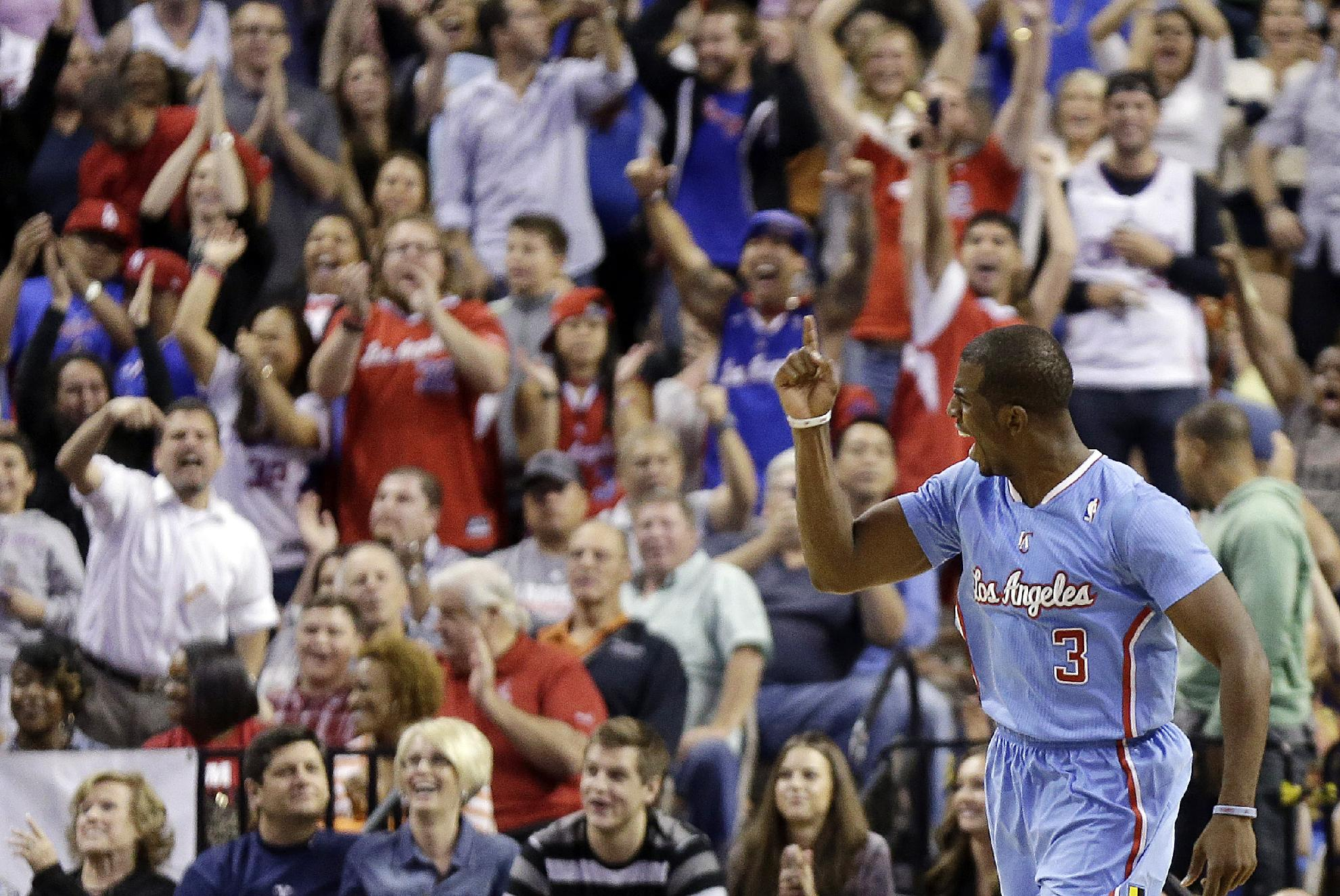 The Los Angeles Clippers' Chris Paul celebrates sinking a game-tying shot during the final seconds of the second half of a preseason NBA basketball game against the Denver Nuggets on Saturday, Oct. 19, 2013, in Las Vegas. The Clippers went on to defeat the Nuggets in overtime 118-111