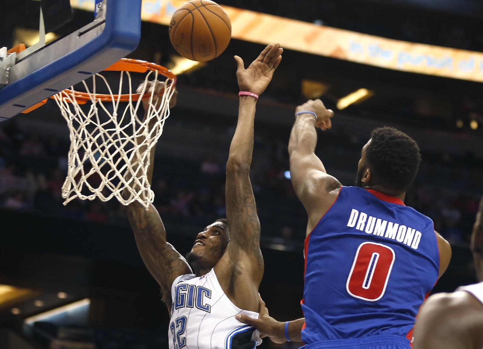 Orlando Magic forward Solomon Jones (22) gets fouled by Detroit Pistons center Andre Drummond (0) during the second half of an NBA basketball game on Sunday,  Oct. 20, 2013, in Orlando, Fla..The Magic won 86-87