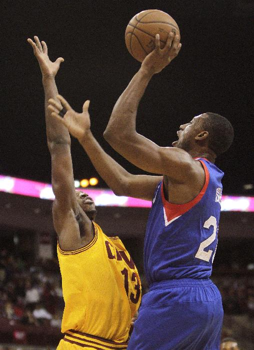 Philadelphia 76ers' Thaddeus Young, right, shoots over Cleveland Cavaliers' Tristan Thompson during the first quarter of an NBA preseason basketball game Monday, Oct. 21, 2013, in Columbus, Ohio