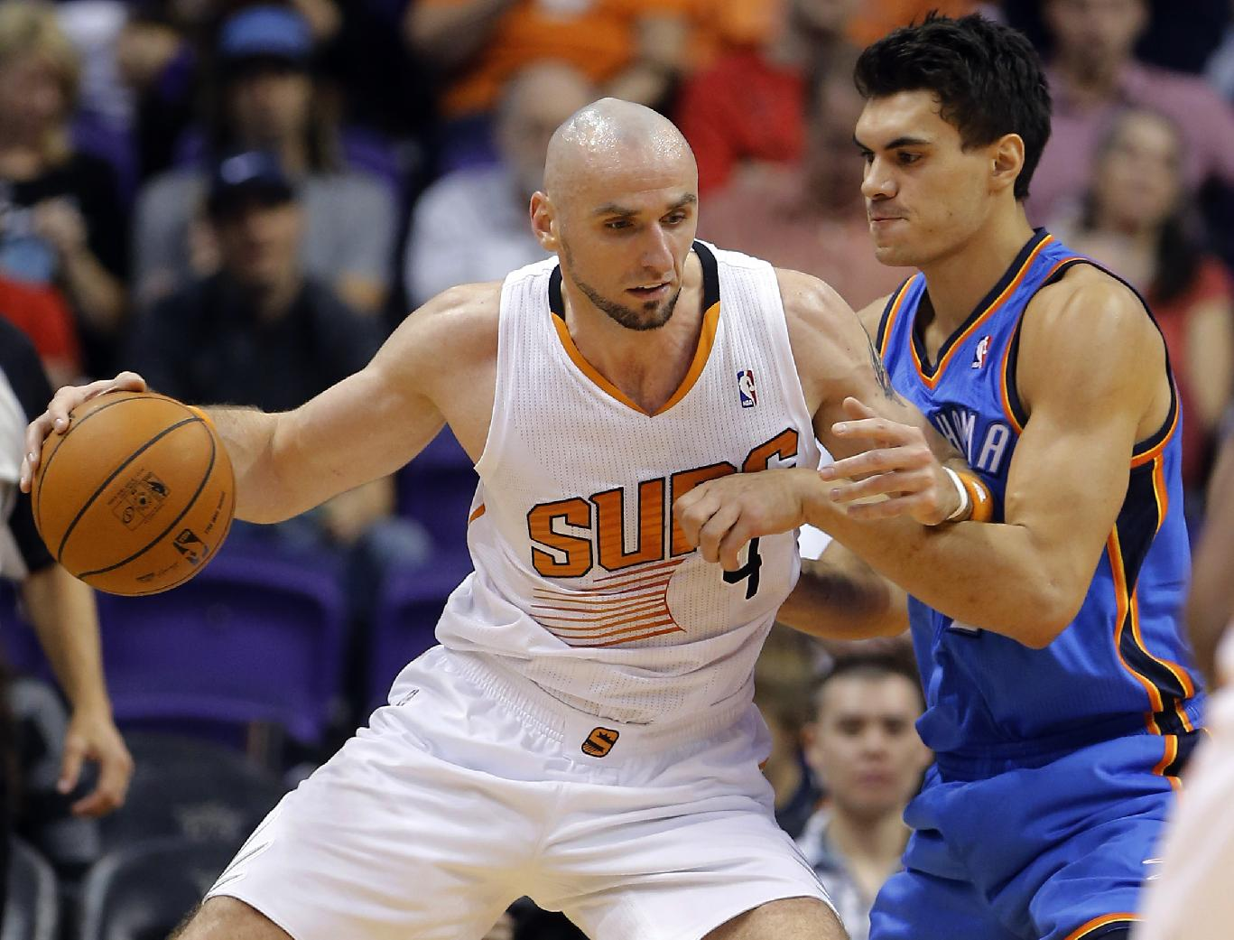 Center Marcin Gortat, left, is headed to the Wizards. (AP)