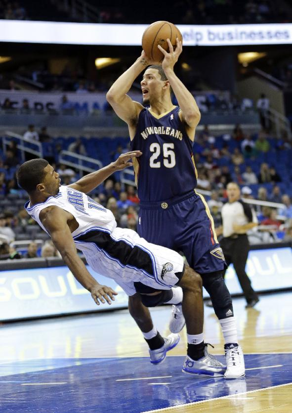 Orlando Magic's Ronnie Price, left, is called for a blocking foul as he tries to stop New Orleans Pelicans' Austin Rivers from making a shot during the second half of an NBA preseason basketball game in Orlando, Fla., Friday, Oct. 25, 2013. New Orleans won 101-82