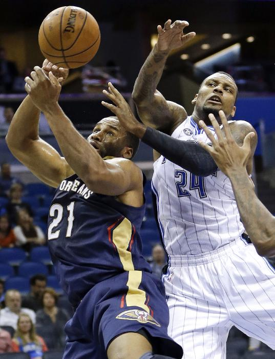 New Orleans Pelicans' Arinze Onuaku (21) and Orlando Magic's Romero Osby go after a rebound during the second half of an NBA preseason basketball game in Orlando, Fla., Friday, Oct. 25, 2013. New Orleans won 101-82