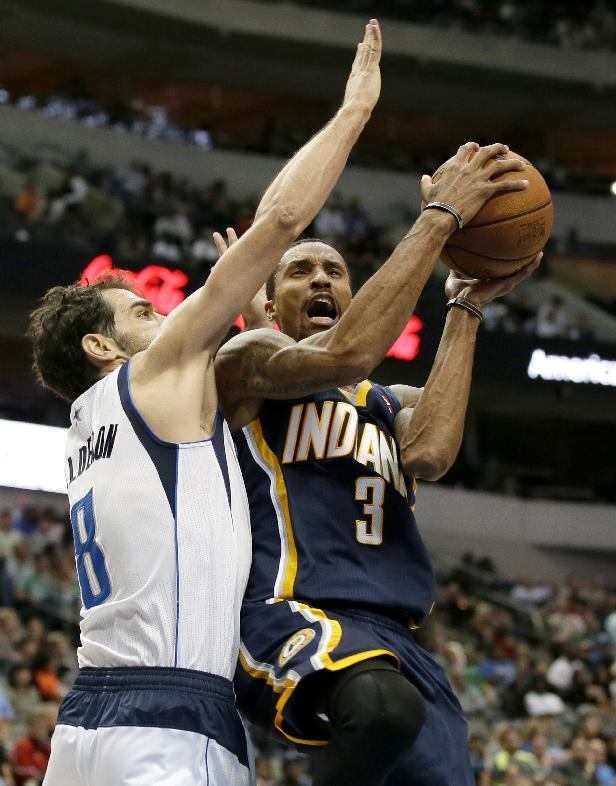 Dallas Mavericks' Jose Calderon (8), of Spain, defends as Indiana Pacers' George Hill (3) goes up for a shot-attempt in the second half of a preseason NBA basketball game on Friday, Oct. 25, 2013, in Dallas
