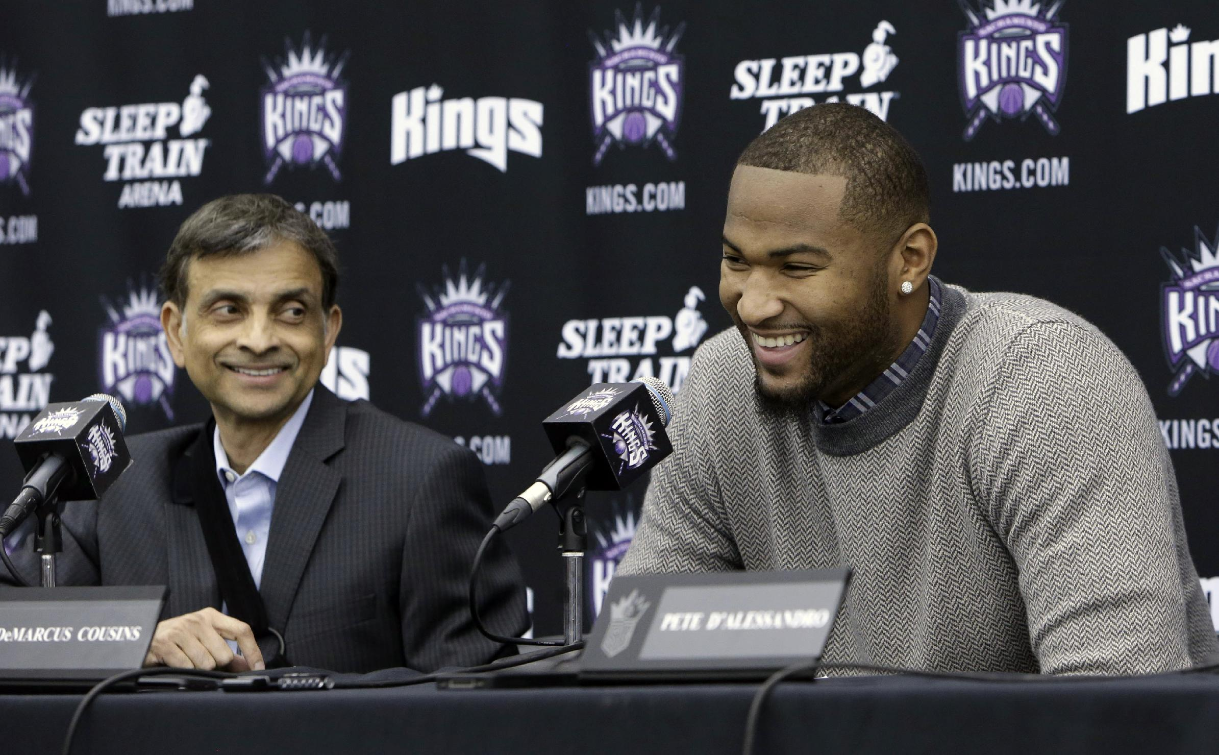 File-In this Sept. 30, 2013 file photo, Sacramento Kings majority owner Vivek Ranadive and Kings center DeMarcus Cousins laugh during a news conference to announce Cousins' signing of four-year contract extension, in Sacramento, Calif.  After purchasing the team earlier this year, Ranadive said the first call he made was to the teams talented, but temperamental center and has made Cousins the centerpiece of the Kings future