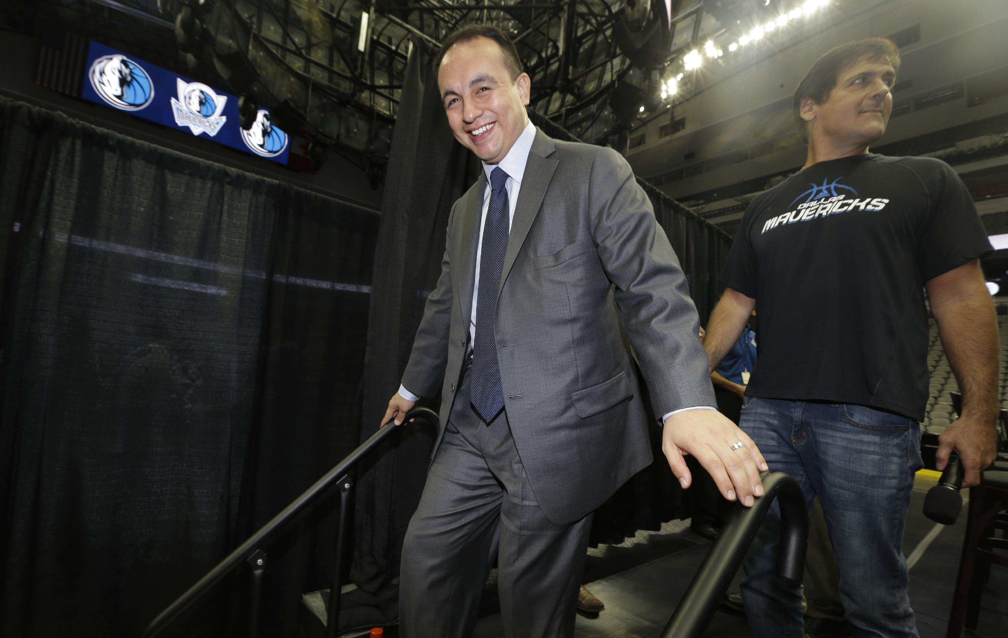 New Dallas Mavericks general manager Gersson Rosas walks off the stage after a news conference introducing free agents signed to the NBA basketball team in the offseason, Thursday, Aug. 15, 2013, in Dallas