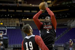 Portland Trail Blazers shooting guard Wesley Matthews (2) shoots over power forward Joel Freeland (19) during a shootaround before their NBA basketball game against the Phoenix Suns Wednesday, Oct. 30, 2013, in Phoenix