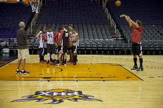 Portland Trail Blazers center Robin Lopez, right,  practices his free throws during a shootaround before their NBA basketball game against the Phoenix Suns Wednesday, Oct. 30, 2013, in Phoenix