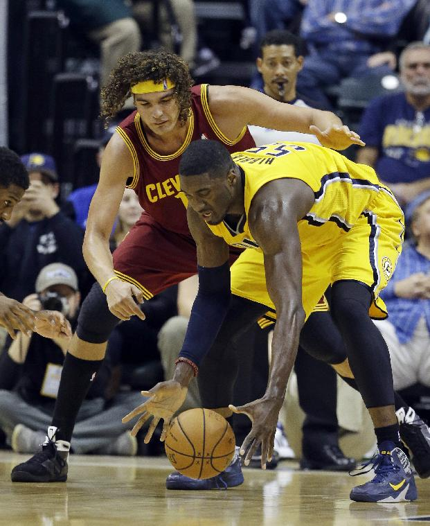 Cleveland Cavaliers' Anderson Varejao, left, and Indiana Pacers' Roy Hibbert battle for a loose ball during the first half of an NBA basketball game Saturday, Nov. 2, 2013, in Indianapolis
