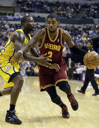 Cleveland Cavaliers' Kyrie Irving, right, is defended by Indiana Pacers' Donald Sloan during the first half of an NBA basketball game Saturday, Nov. 2, 2013, in Indianapolis