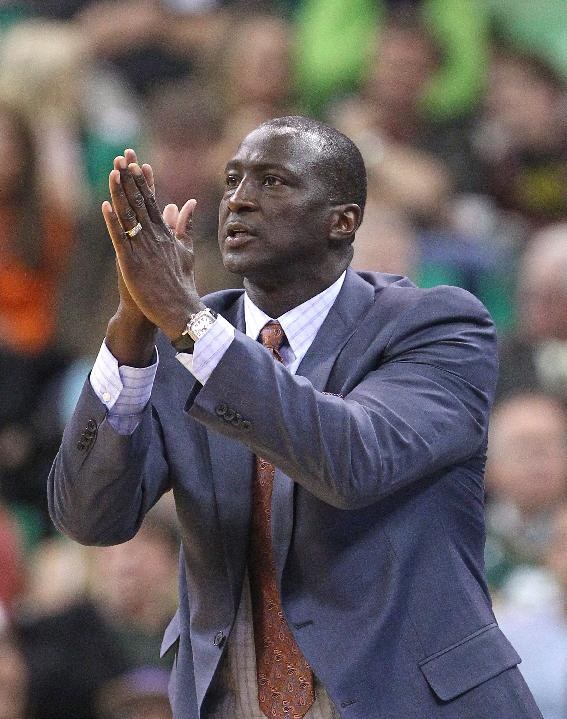 Utah Jazz head coach Tyrone Corbin shouts to his team in the first half during an NBA basketball game against the Houston Rockets, Saturday, Nov. 2, 2013, in Salt Lake City