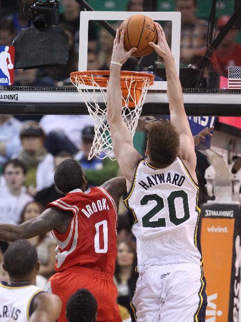 Utah Jazz's Gordon Hayward (20) dunks the ball over Houston Rockets' Aaron Brooks (0) in the second quarter during an NBA basketball game Saturday, Nov. 2, 2013, in Salt Lake City