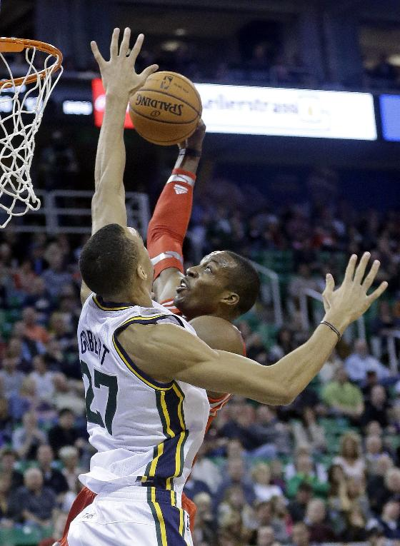 Houston Rockets' Dwight Howard, right, goes to the basket as Utah Jazz's Rudy Gobert (27), of France, defends in the first quarter during an NBA basketball game Saturday, Nov. 2, 2013, in Salt Lake City