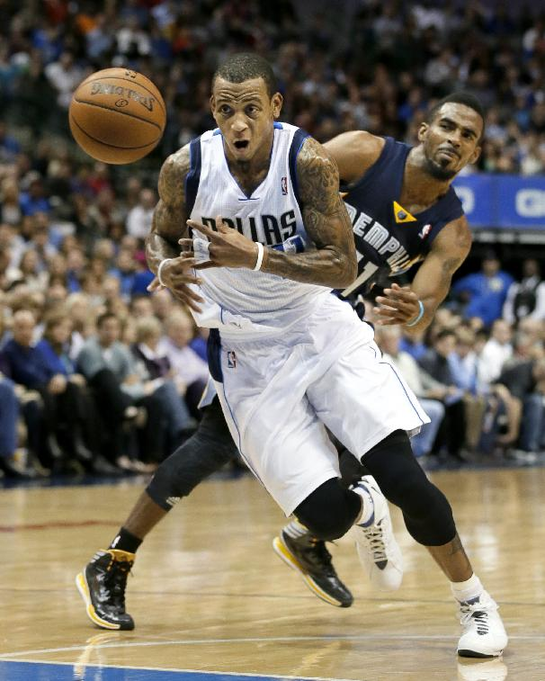 Dallas Mavericks' Monta Ellis, front, has the ball punched away from behind by Memphis Grizzlies' Mike Conley, rear, on a drive to the basket in the second half of an NBA basketball game Saturday, Nov. 2, 2013, in Dallas. Ellis contributed 18-points to the 111-99 Mavericks win