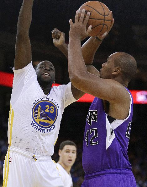Sacramento Kings' Chuck Hayes, right, shoots against Golden State Warriors' Draymond Green during the first half of an NBA basketball game on Saturday, Nov. 2, 2013, in Oakland, Calif