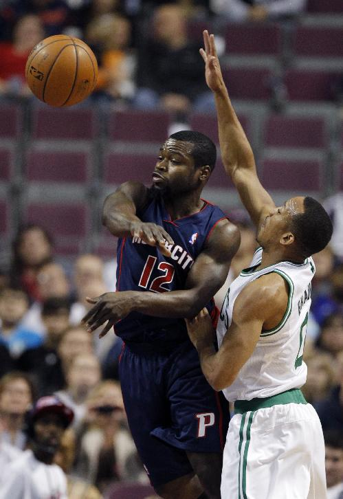 Detroit Pistons guard Will Bynum (12) passes the ball against Boston Celtics guard Avery Bradley during the first half of an NBA basketball game Sunday, Nov. 3, 2013, in Auburn Hills, Mich