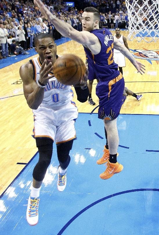 Oklahoma City Thunder guard Russell Westbrook (0) goes to the basket in front of Phoenix Suns center Miles Plumlee in the first quarter of an NBA basketball game in Oklahoma City, Sunday, Nov. 3, 2013. Oklahoma City won 103-96