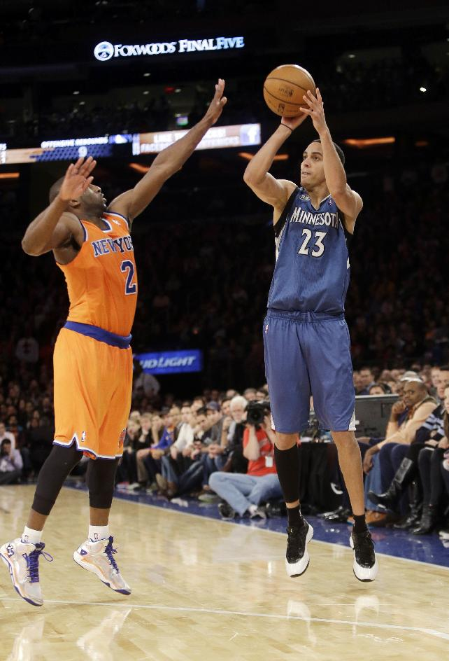 Minnesota Timberwolves' Kevin Martin (23) shoots over New York Knicks' Raymond Felton (2) during the second half of an NBA basketball game Sunday, Nov. 3, 2013, in New York. The Timberwolves won 109-100