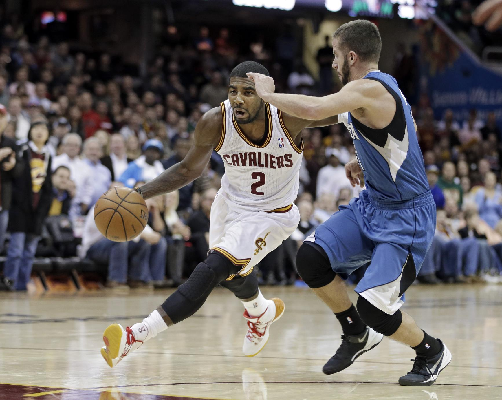 Cleveland Cavaliers' Kyrie Irving (2) drives past Minnesota Timberwolves' J.J. Barea in the fourth quarter of an NBA basketball game Monday, Nov. 4, 2013, in Cleveland. Irving scored 15 points in the Cavaliers' 93-92 win