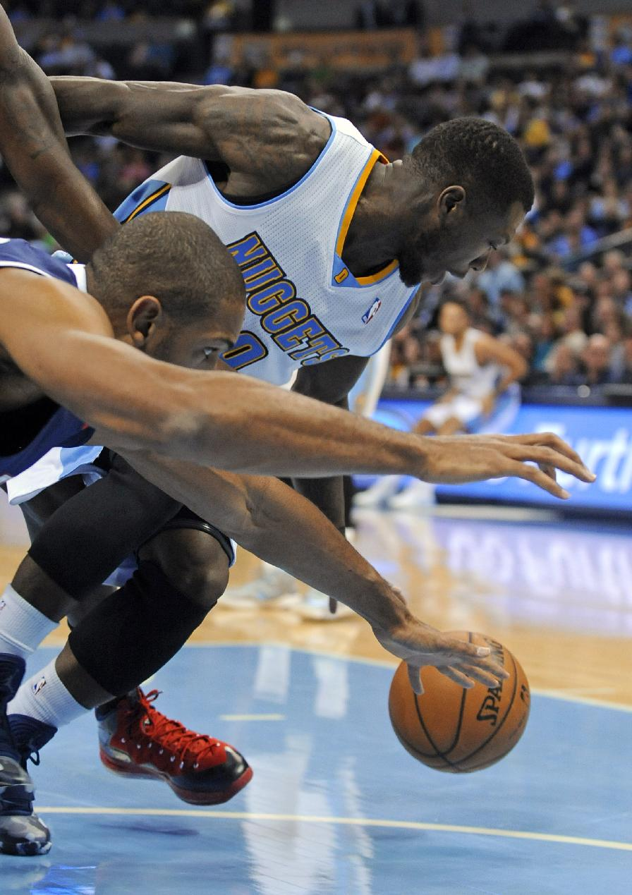 Denver Nuggets guard Nate Robinson, rear, and Atlanta Hawks center Al Horford chase a loose ball during the first quarter of an NBA basketball game Thursday, Nov. 7, 2013, in Denver